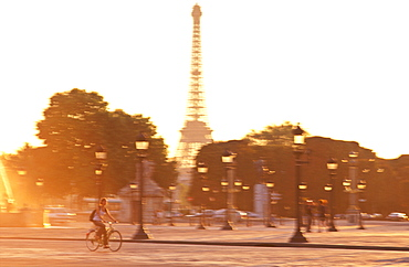 Cyclist in the Place de la Concorde, and Eiffel Tower behind, Paris, France, Europe