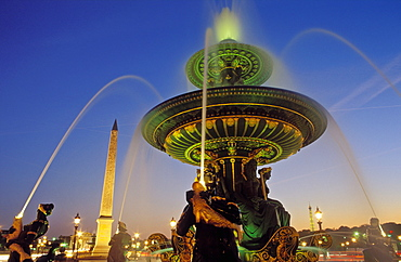 Fountains and Place de la Concorde illuminated at night, Paris, France, Europe