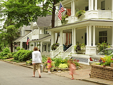 Mother walking on street with two young girls, Chautauqua, New York State, United States of America, North America