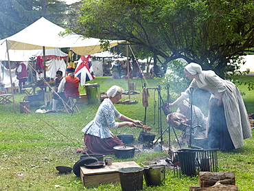 French-Indian War reenactment, women cooking a turkey over an open fire, Fort Niagara, Youngstown, New York State, United States of America, North America