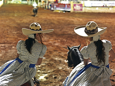 Mexican charras, female cowgirls, on horses at rodeo, Guadalajara, Jalisco, Mexico, North America