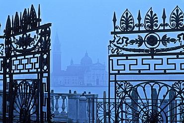 View of San Giorgio Maggiore from The Giardinetti Reali (royal gardens) framed through an iron gate, Venice, UNESCO World Heritage Site, Veneto, Italy, Europe