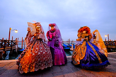 Masks and costumes at St. Mark's Square during Venice Carnival, Venice, Veneto, Italy, Europe