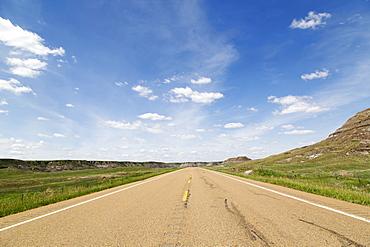 Blue sky over a highway through the Badlands of Alberta, near Drumheller, Alberta, Canada, North America