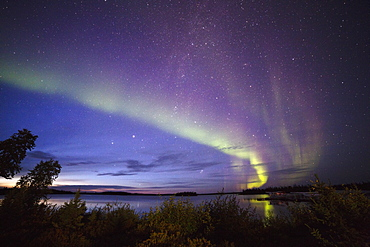 The Northern Lights (aurora borealis) in the night sky above Lake Egenolf in northern Manitoba, Canada, North America