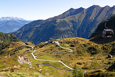 View towards the mid-station of the Panoramabahn gondola style cable car on the Kitzsteinhorn mountainside, Austria, Europe