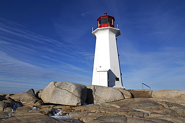Peggy's Point Lighthouse on a winter day at Peggys Cove, one of the points on the Lighthouse Route, Nova Scotia, Canada, North America