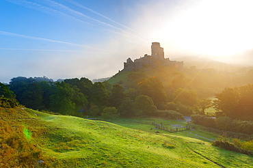 Corfe Castle at sunrise, Dorset, England, United Kingdom, Europe