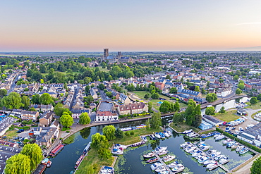 Drone view of Ely Cathedral with Ely Marina and Great Ouse River in foreground, Ely, Cambridgeshire, England, United Kingdom, Europe - 828-1444