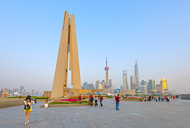 Monument to the People's Heroes, Huangpu Park, The Bund, Huangpu District, with the Pudong skyline beyond, Shanghai, China, Asia