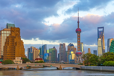 Pudong Financial District skyline, including Oriental Pearl Tower, and bridge over Wusong River (Suzhou Creek), Shanghai, China, Asia