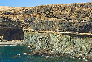 Unconformity of older Jurassic sediments and Pliocene limestone plus later lava on top at Caleta Negra, Ajuy, Fuerteventura, Spain, Atlantic, Europe