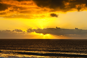 Sunset lighting the clouds offshore from this village on the north west coast, El Cotillo, Fuerteventura, Canary Islands, Spain, Atlantic, Europe
