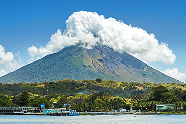 The 1610m Volcan Concepcion looms behind port of Moyogalpa in west of the island, Moyogalpa, Isla Omotepe, Lake Nicaragua, Nicaragua, Central America