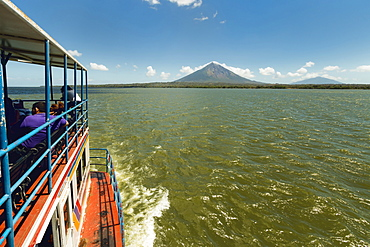 Ferry and the twin peaks of Omotepe Island's volcanoes Concepcion on left and Maderas, Isla Omotepe, Lake Nicaragua, Nicaragua, Central America