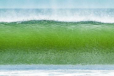 Classic tubular shore break surfing wave typical of this region, Playa Hermosa, San Juan del Sur, Rivas Province, Nicaragua, Central America