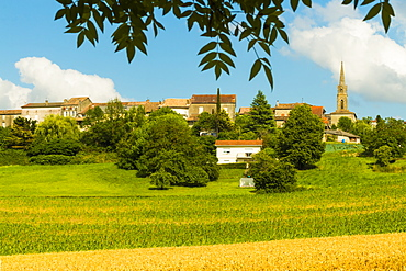 View over fields in summer towards this quiet hilltop village near Duras, Levignac-de-Guyenne, Lot-et-Garonne, Aquitaine, France, Europe