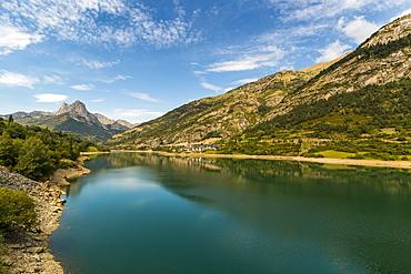 Lanuza lake and village and Pena Foratata peak in the scenic upper Tena Valley, Sallent de Gallego, Pyrenees, Huesca Province, Spain, Europe