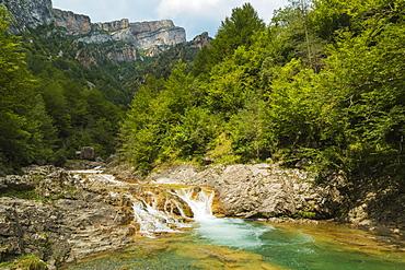 Waterfall on Rio Bellos river in the limestone Anisclo Canyon, Ordesa National Park, Anisclo, Pyrenees, Aragon, Spain, Europe