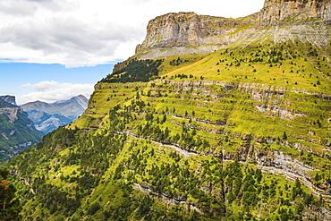 View west along the Ordesa Valley's north rim to distant Otal Peak, Ordesa National Park, Pyrenees, Aragon, Spain, Europe
