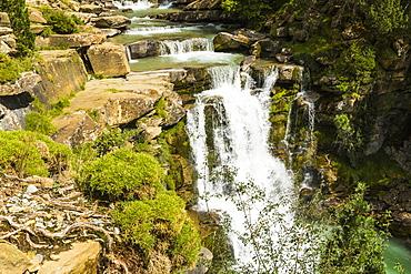 Steps of limestone strata make a waterfall on the Rio Arazas, upper Ordesa Valley, Ordesa National Park, Pyrenees, Aragon, Spain, Europe