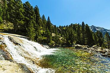 Waterfall below Llano de Bozuelo, Rio Caldares hiking trail from Banos de Panticosa, Panticosa, Pyrenees, Huesca Province, Spain, Europe