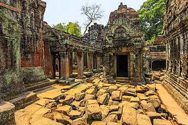 Gopura entrance and weathered carved sandstone walls in the 12th century Preah Khan (Prah Khan) Buddhist temple complex, Angkor, UNESCO World Heritage Site, Siem Reap, Cambodia, Indochina, Southeast Asia, Asia