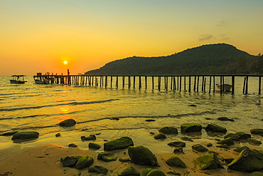 Sunset and pier on the quiet rocky west coast of this holiday island, Lazy Beach, Koh Rong Sanloem Island, Sihanoukville, Cambodia, Indochina, Southeast Asia, Asia