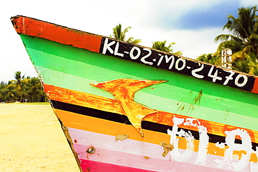 Prow of colourfully decorated fishing boat on popular Marari Beach, Mararikulam, Alappuzha (Alleppey), Kerala, India, Asia
