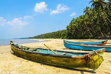 Fishing boats at lovely unspoilt, Kizhunna Beach, south of Kannur on the Keralan north coast, Kizhunna, Kannur, Kerala, India, Asia