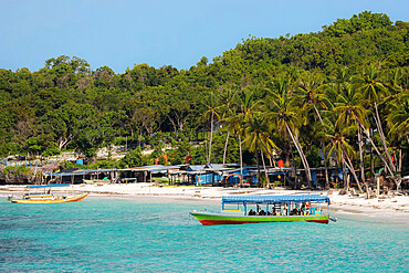 Tourist dive boat moored by white sand Bira Beach at this far South resort town; Tanjung Bira, South Sulawesi, Indonesia