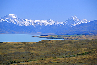 Looking north along Lake Pukaki towards the Southern Alps, with Mt Sefton, left, and Mt Cook, right; (glacial sediment causes the blue of many NZ lakes), Canterbury, South Island, New Zealand