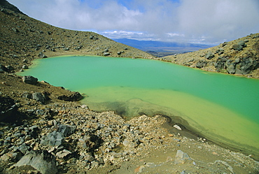 One of the Emerald Lakes, explosion craters filled with mineral-tinted water, on Mount Tongariro in the Tongariro National Park on the central plateau, North Island, New Zealand