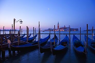 Daybreak view of gondolas from Piazzetta San Marco to Isole of San Giorgio Maggiore, Venice, UNESCO World Heritage Site, Veneto, Italy, Europe
