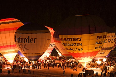 Hot air balloons glowing against a night sky, Filzmoos, Salzburg, Austria, Europe
