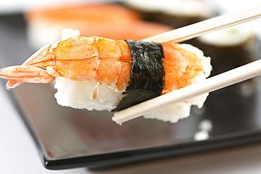 Sushi on chop sticks