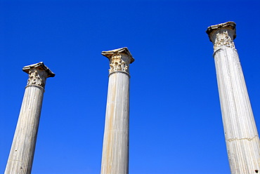 Three ancient pillars with blue sky Gymnasium archaeological site Salamis North Cyprus