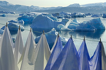 Clothesline with laundry in front of icebergs in Sermilik Fjord Tiniteqilaaq Eastgreenland