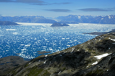 Wide open view over rocks to icebergs glaciers and mountains Sermilik Fjord Eastgreenland