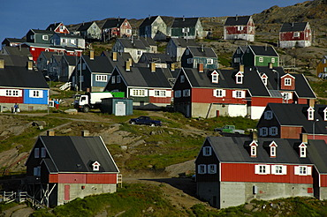 Colourful houses at a slope settlement Ammassalik Eastgreenland