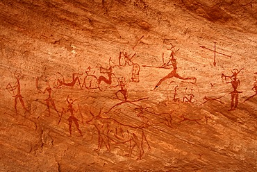Neolithic rock drawing of humans and animals at hunt Acacus Libya