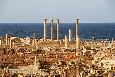 View over excavation site walls and pillars at the sea Sabratha Libya