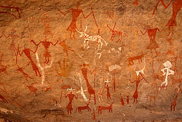 Neolithic rock drawing of humans and animals Acacus Libya