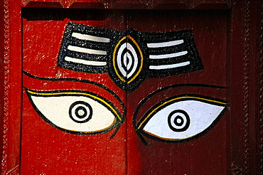 Red painted door with two eyes watching Durbar Square Kathmandu Nepal