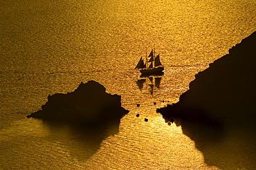 Sailing ship at sunset, Oia, Santorini, Cyclades, Aegean Sea, Greece