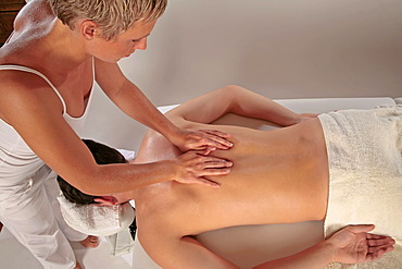 Massaging back musculature