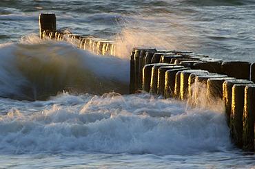 Waves breaking at a groyne at dusk Baltic Sea Germany