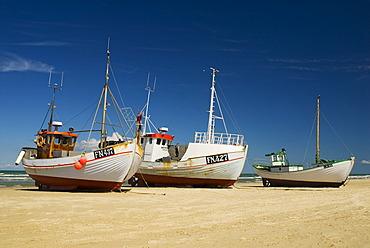Fishing boats lying on the beach in Loekken, Jutland, Denmark