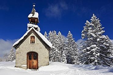 Snowy chapel in Traunstein, Bavaria, Germany, Europe