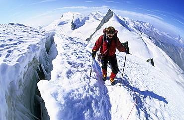Woman near a crevasse on Allalinhorn Valais Switzerland